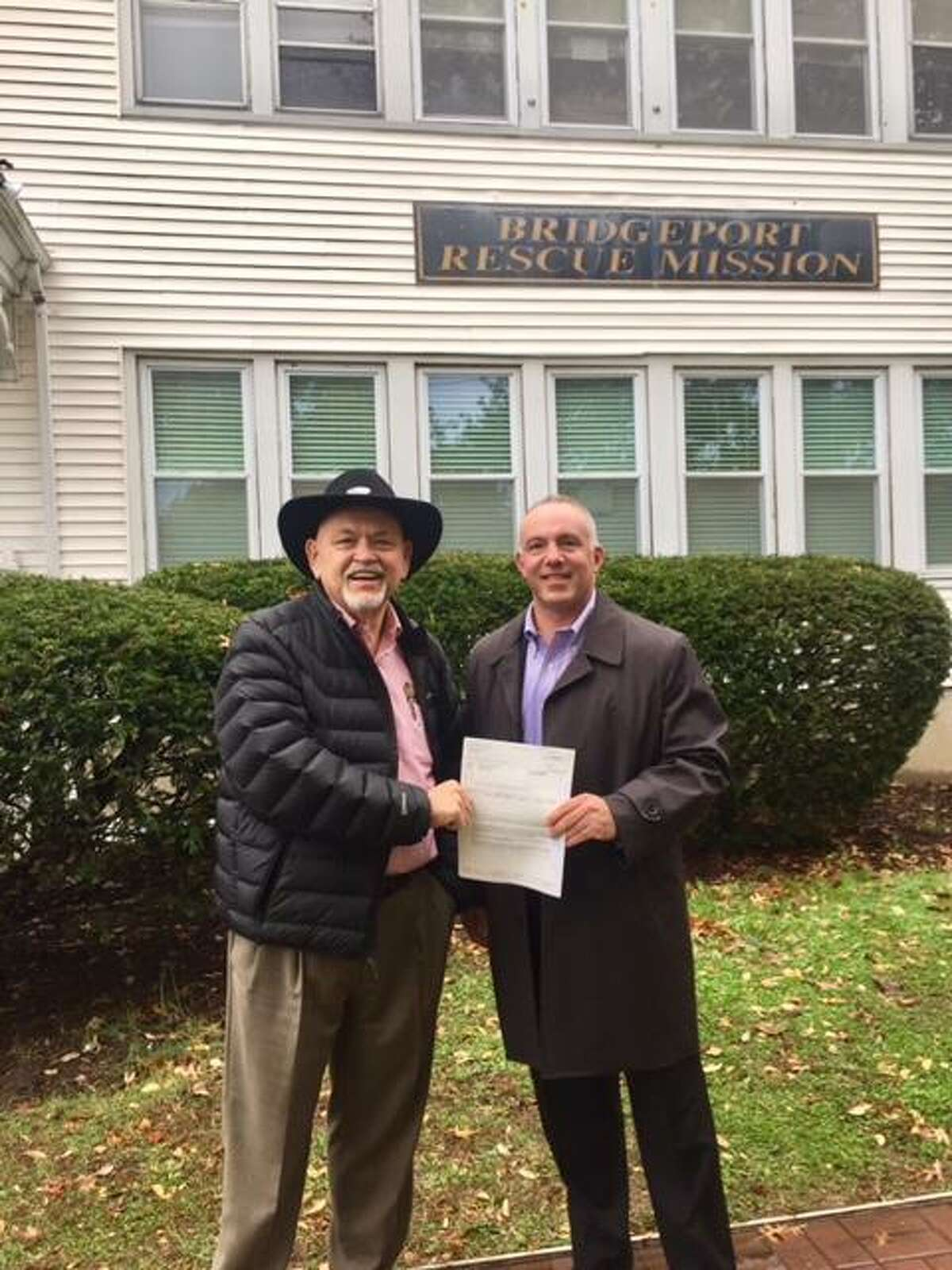 Terry Wilcox,Bridgeport Rescue Mission Executive Director, leftand Steve Delany, Enterprise Holdings' Southern New England Regional Vice President.