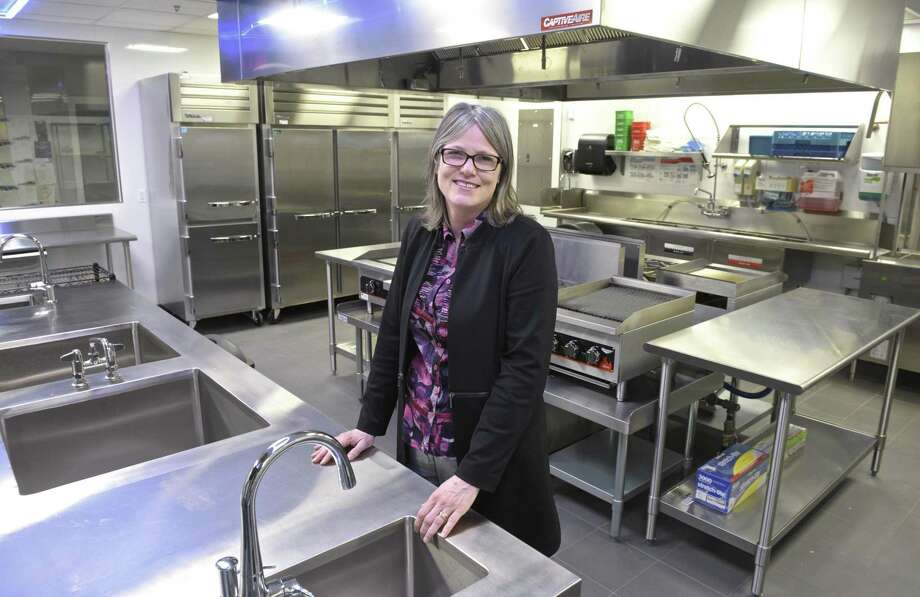 Workspace Education Founder and Executive Director Catherine Fraise stands in the state-of-art kitchen that the school built to go with their new culinary program. Tuesday, March 12, 2019, in Bethel, Conn. Photo: H John Voorhees III / Hearst Connecticut Media / The News-Times