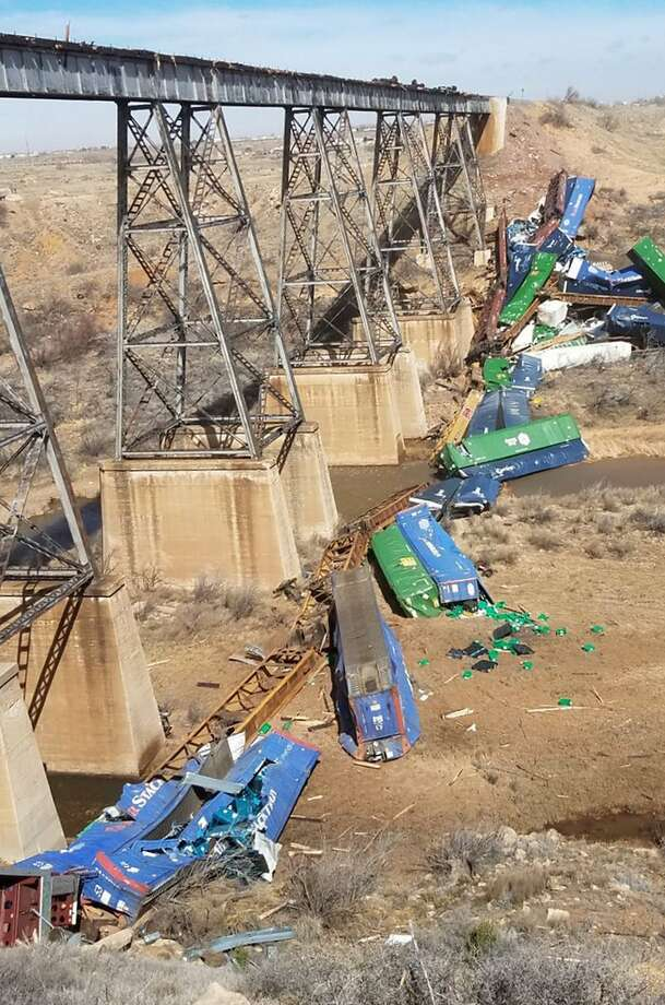 In the Wednesday, March 13, 2019, photo released by the New Mexico State Police shows shipping containers strewn across the river bed, with a jumbled pile of containers on the slope above one bank of the Canadian River near Logan, N.M., about 184 miles (296 kilometers) east of Albuquerque. Union Pacific spokeswoman Raquel Espinoza said the derailed cars were the tail end of a mixed-freight train consisting of two locomotives and 73 rail cars. Authorities blamed high winds for a train derailment in eastern New Mexico where approximately 25 freight cars went off a trestle over a mostly dry river bed. (New Mexico State Police via AP) Photo: Associated Press