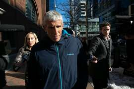 William Singer leaves the federal courthouse in Boston after pleading guilty in charges related to college admission schemes, March 13, 2019. The accusations against Singer pose potential problems for the organizations behind the two most widely used college admissions tests, the SAT and the ACT, which most colleges weigh in evaluating prospective students. (Katherine Taylor/The New York Times)