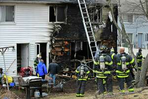 The Norwalk Fire Department responds to a fire at Colonial Village public housing complex Wednesday, March 13, 2019, in Norwalk, Conn. two families were displaced by the fire.