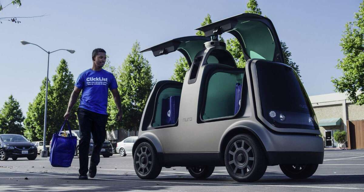 This undated image provided by The Kroger Co. shows an autonomous vehicle called the R1. Nuro and grocery chain Kroger are teaming up to bring unmanned delivery service to customers.