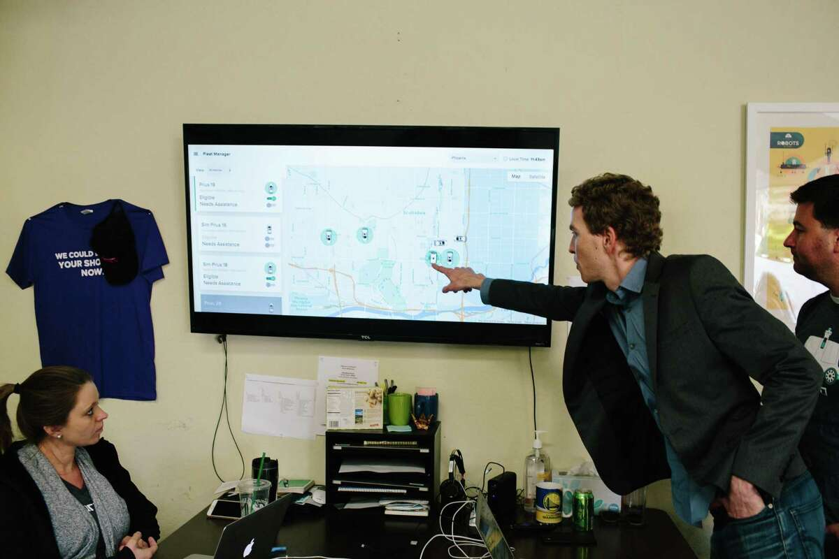 Nuro Co-Founder Dave Ferguson points to a live map of autonomous delivery vehicles in Scottsdale, Ariz., on Dec. 13, 2018. Nuro's self-driving mini cars are running as part of a partnership with Fry's Food Store on an autonomous delivery service.