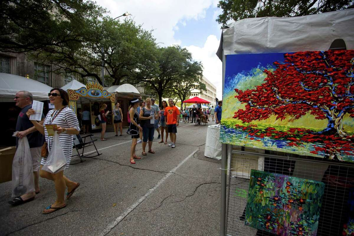 People stroll up and down booth-lined streets during the Bayou City Art Fest on Saturday, October 14, 2017, in Houston. The two-day Bayou City Art Festival features 300 artists from around the country and 19 different disciplines, music and live entertainment throughout the festival, food trucks, a Children's Creative Zone with crafts and entertainment for children of all ages. (Annie Mulligan / Freelance)