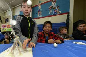 West Rocks Elementary School sixth-grader Josue Alvarado launches his team's catapult project during the citywide STEM Expo in March 2018.