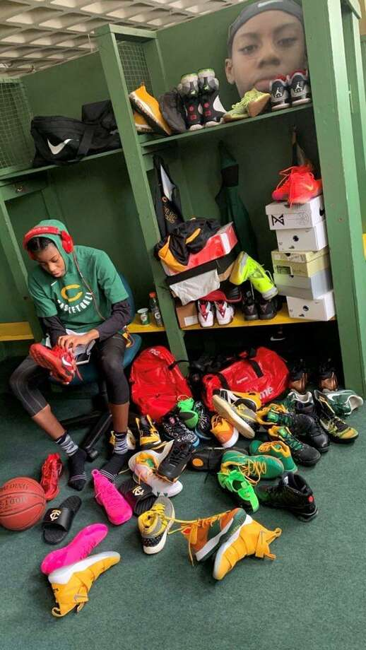 Trinity Catholic star Iyanna Lops at her locker with her sneaker collection. Photo: Contributed Photo / Contributed Photo / Stamford Advocate Contributed
