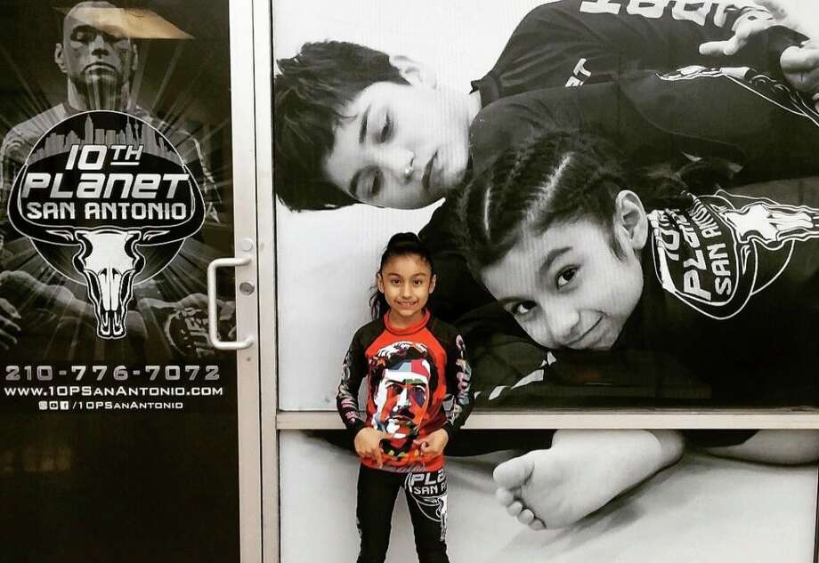 "Meet Apolonia ""Apple"" Nuncio, a young grappler and new social media sensation thanks to a Twitter video posted by her older sister Aundria. Following her Saturday match against a boy 15 pounds heavier than her, Apolonia's proud big sister shared a video showing what went down like she normally does. Photo: Courtesy, Nuncio Family"