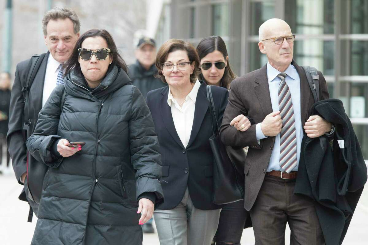 Nancy Salzman, center, leaves Brooklyn Federal court, Wednesday, March 13, 2019, in New York. Salzman, co-founder of NXIVM, the embattled upstate New York self-help organization has pleaded guilty in a case featuring sensational claims that some followers became branded sex slaves.