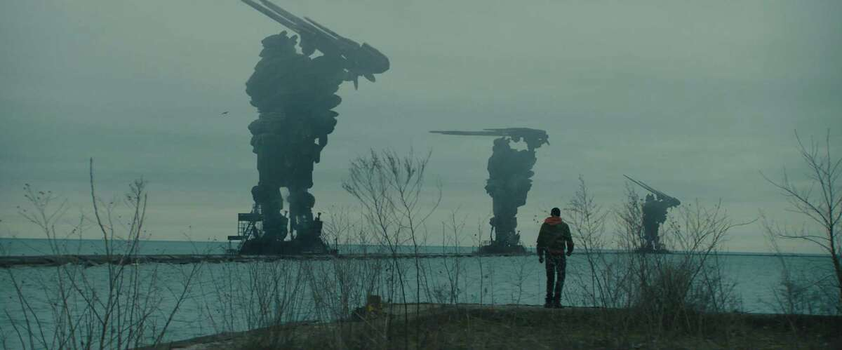 """Gabriel (Ashton Sanders) looks on alien installations in Lake Michigan in Rupert Wyatt's """"Captive State,"""" opening at Bay Area theaters March 15. Ashton Sanders stars as Gabriel in Rupert Wyatt's CAPTIVE STATE, a Focus Features release. Credit: Focus Features"""