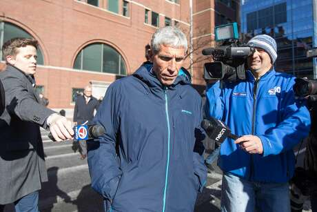 """BOSTON, MA - MARCH 12:  William """"Rick"""" Singer leaves Boston Federal Court after being charged with racketeering conspiracy, money laundering conspiracy, conspiracy to defraud the United States, and obstruction of justice on March 12, 2019 in Boston, Massachusetts. Singer is among several charged in an alleged college admissions scam involving parents, ACT and SAT administrators and coaches at universities including Stanford, Georgetown, Yale, and the University of Southern California. (Photo by Scott Eisen/Getty Images)"""