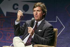 Tucker Carlson speaks onstage during Politicon 2018 at Los Angeles Convention Center on October 21 in Los Angeles, California. Media Matters has unearthed remarks many are labeling as mysoginist and racist and that should get him fired from Fox.