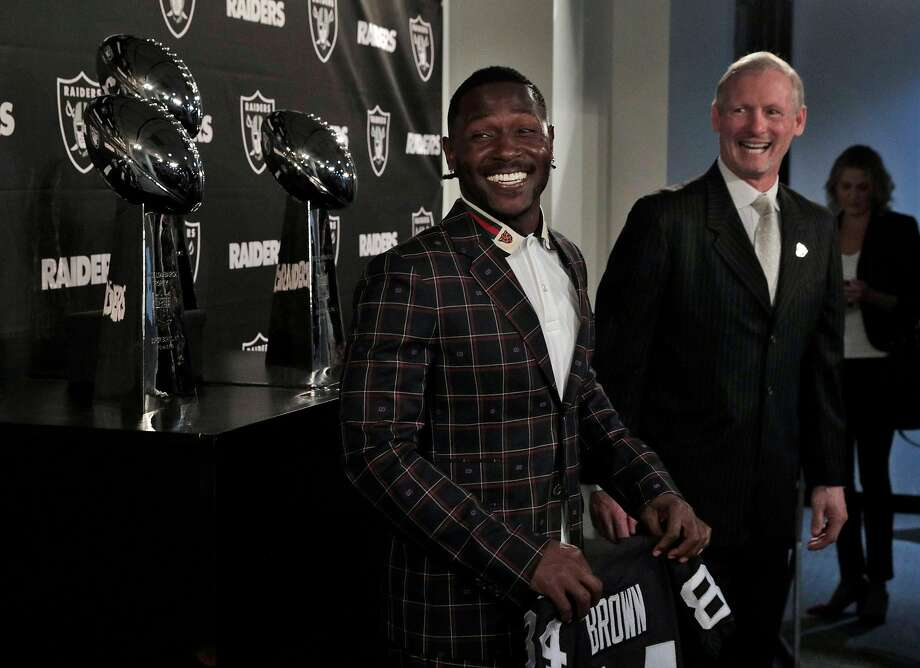 FILE - Antonio Brown, left, smiles with General Manager Mike Mayock, right, after the Raiders announced his arrival at their team headquarters in Alameda, Calif., on Wednesday, March 13, 2019. Photo: Carlos Avila Gonzalez / The Chronicle