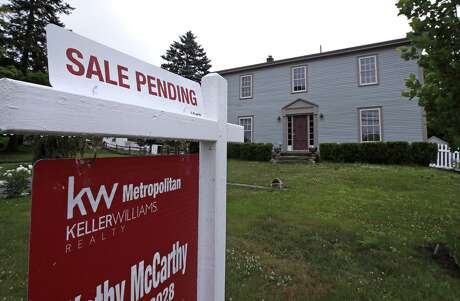 "FILE- This June 15, 2018, file photo shows a ""sale pending"" sign is posted outside a home in East Derry, N.H. On Wednesday, Feb. 27, 2019, the National Association of Realtors releases its January report on pending home sales, which are seen as a barometer of future purchases. (AP Photo/Charles Krupa, File)"