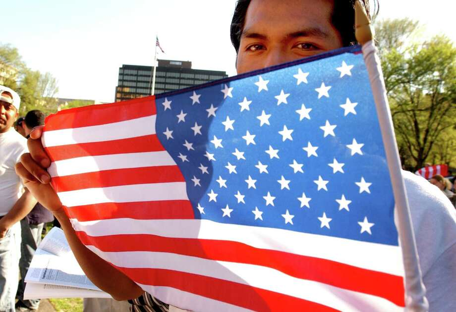 In a file photo, a Hispanic protester held an American flag during a pro-immigration rally and march in New Haven. Photo: /