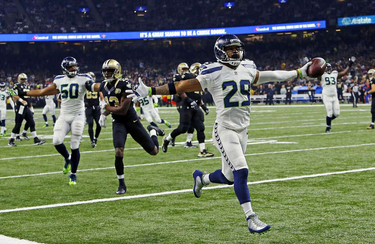 Seattle Seahawks free safety Earl Thomas (29) returns a fumble for a touchdown in the first half of an NFL football game against the New Orleans Saints in New Orleans, Sunday, Oct. 30, 2016. (AP Photo/Butch Dill)