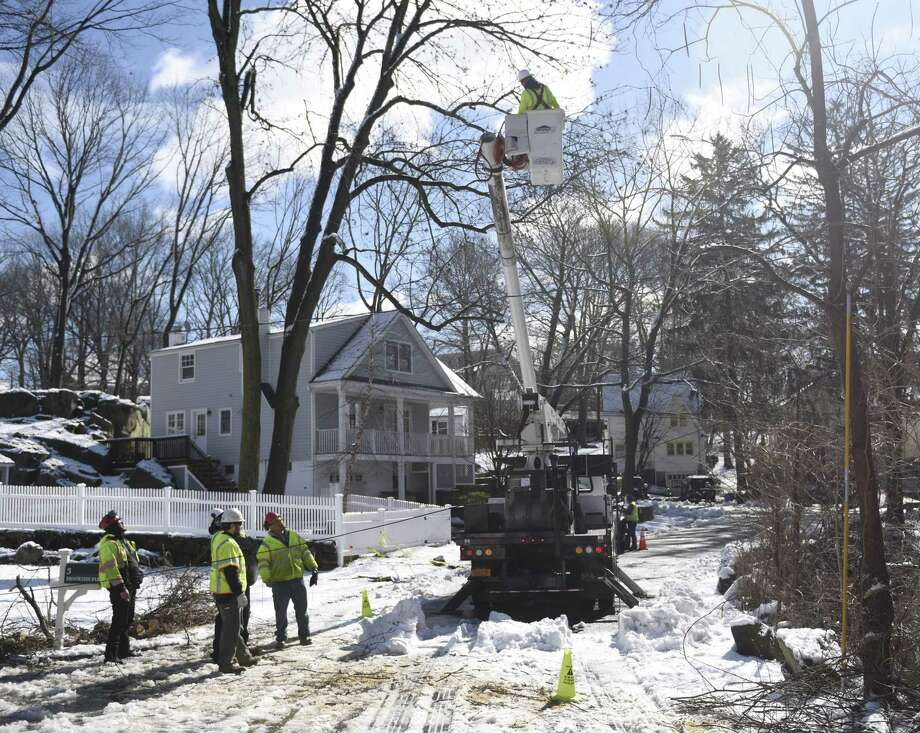 Crews remove trees and repair power lines on Brookside Park in Old Greenwich, Conn. Thursday, March 8, 2018. The area received about eight inches of snow with strong winds Wednesday and crews spent Thursday removing fallen trees and restoring power to the community. Photo: Tyler Sizemore / Hearst Connecticut Media / Greenwich Time