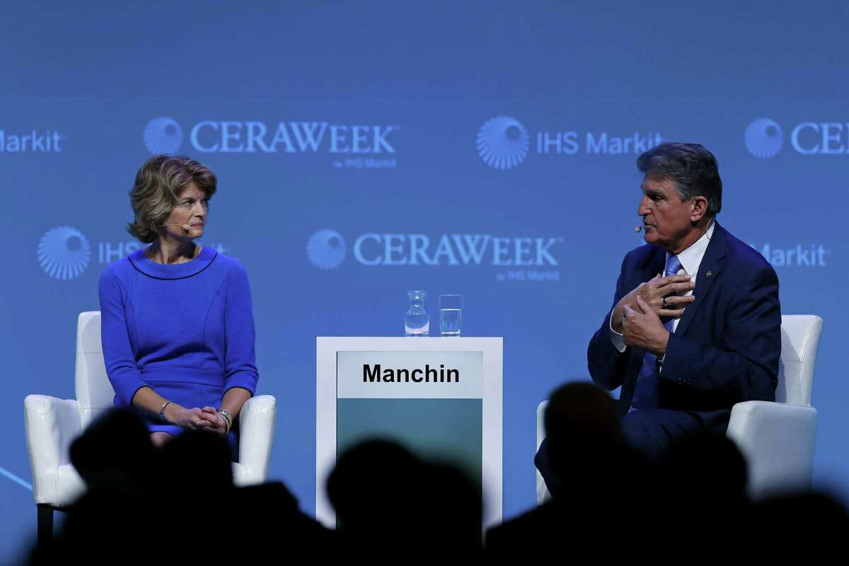 Senator Joe Manchin, a Democrat from West Virginia, right, Lisa Murkowski, a Republican from Alaska, called for a bipartisan approach to climate change.