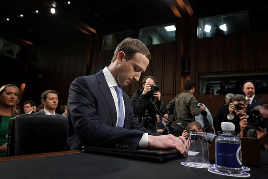 FILE-- Facebook CEO Mark Zuckerberg testifies before Congress in April 2018. Federal prosecutors are conducting a criminal investigation into controversial data-sharing deals Facebook struck with dozens of tech companies, The New York Times reported Wednesday. Photo: Alex Wong/Getty Images
