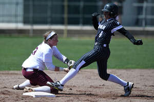 Lee's Abby Jordan attempts to tag out Permian's Madison Garcia (4) at second base, March 13, 2019, at Gene Smith Field. James Durbin / Reporter-Telegram