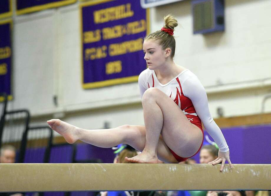 Greenwich's Kelsey Fedorko competes on the beam at the FCIAC Championship on Feb. 9 at Westhill High School in Stamford. Photo: Matthew Brown / Hearst Connecticut Media / Stamford Advocate