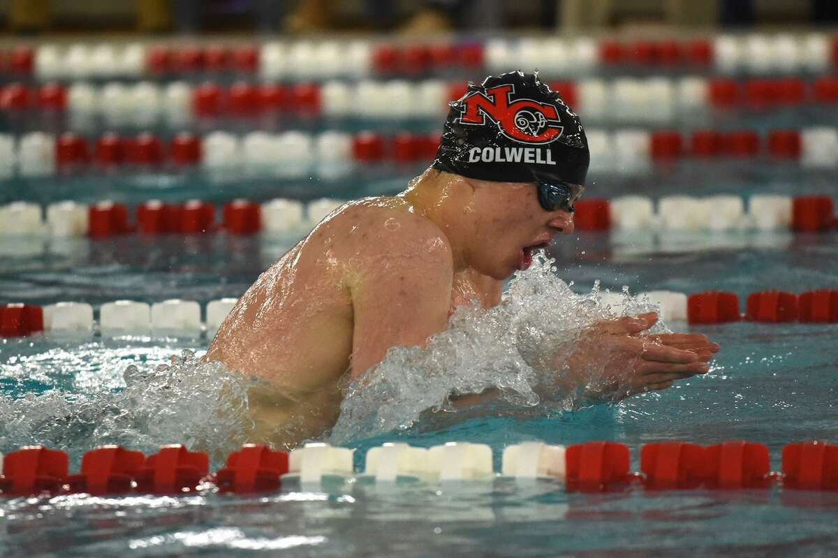 New Canaan's Patrick Colwell swims to a gold medal in the 200-yard individual medley at the FCIAC Swimming Championships on Feb. 28 Greenwich High School.