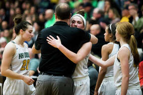 Dow's Charis Queary hugs head coach Kyle Theisen during the final moments of the Chargers' 49-34 Division 1 regional finals loss to Saginaw Heritage on Wednesday, March 13, 2019 at Bay City Western High School. (Katy Kildee/kkildee@mdn.net)