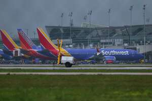 Southwest Airlines planes sit on the Hobby Airport tarmac in 2019.