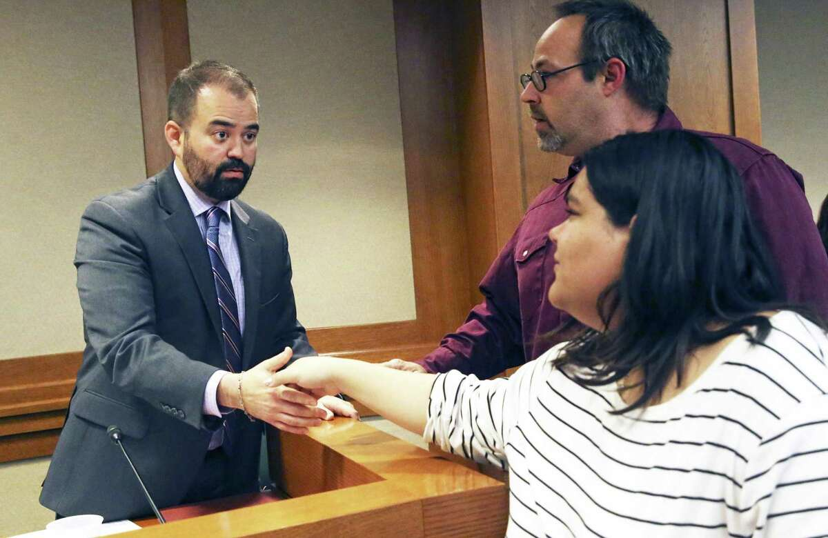 Rep. Joseph Moody, D-El Paso, is thanked by Mercedes Stone and John Conard for offering to amend the legislation as Santa Fe families appear Wednesday in Austin to voice their opposition to HB256 which would reduce length of sentences for offenders under 18 years of age on March 13, 2019.