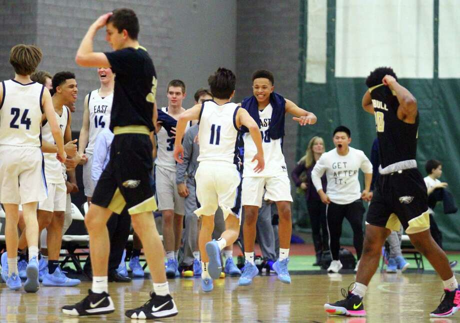 Trumbull players walk off the court after being defeated by East Catholic in CIAC Division I state semifinal action in New Haven, Conn., on Wednesday Mar. 13, 2019. Photo: Christian Abraham / Hearst Connecticut Media / Connecticut Post