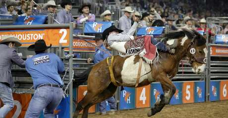 Clayton Biglow competes in the bareback riding during the first semifinal round at the Houston Livestock Show and Rodeo Wednesday, March 13, 2019, in Houston.