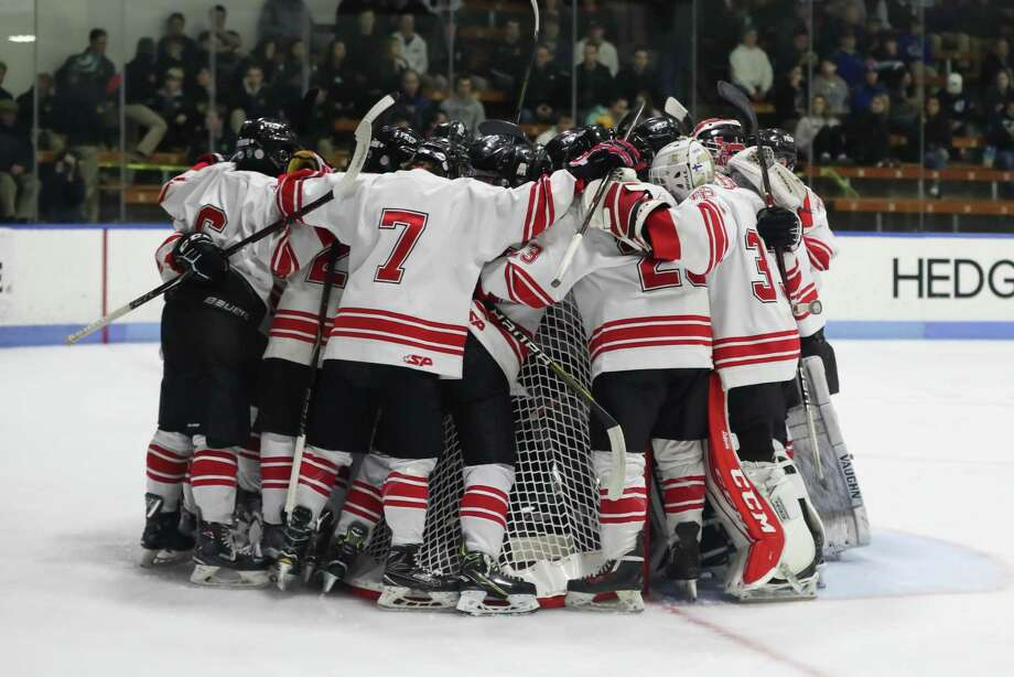 Fairfield Prep gathers around their goalie for a pre-game speech by the captains before Wednesday night's state playoff game against Xavier in New Haven. Photo: John McCreary / For Hearst Connecticut Media / Connecticut Post Freelance