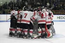 Fairfield Prep gathers around their goalie for a pre-game speech by the captains before Wednesday night's state playoff game against Xavier in New Haven.
