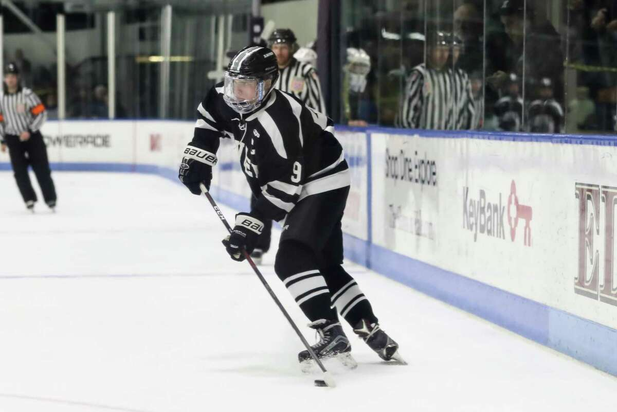 Chase Maxwell (9) of Xavier controls the puck during the Connecticut Division I Hockey Semifinal Game between Xavier and Fairfield Prep on March 13, 2019 at Ingalls Rink (Yale) in New Haven, CT.