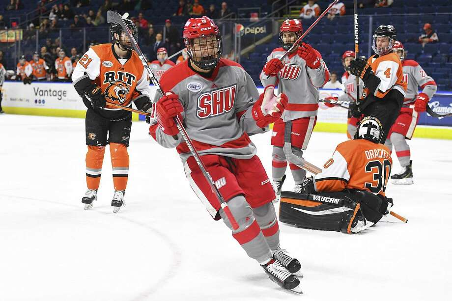 Sacred Heart's Alex Bates celebrates during the Pioneers' 9-4 win over RIT in the Atlantic Hockey quarterfinals at Webster Bank Arena Wednesday in Bridgeport. Photo: Steve McLaughlin / Sacred Heart University / Stamford Advocate Contributed