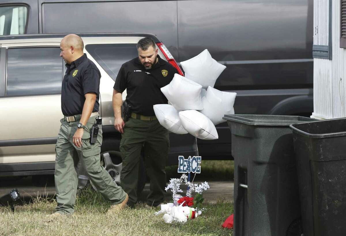 A memorial is in place on Dec. 22, 2017, as law enforcement officials investigate the scene where four Bexar County sheriff's deputies accidentally shot and killed Kameron Prescott, 6, who was inside his family's mobile home. The deputies were pursuing a suspect, Amanda Lenee Jones, in the 100 block of Peach Lane in Schertz. She was also shot and killed Dec. 21. On Wednesday, a grand jury did not indict the four deputies, finding no probable cause that a crime was committed.