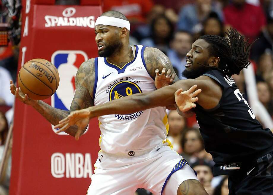 Houston Rockets forward Kenneth Faried (35) reaches to the ball and fouls Golden State Warriors center DeMarcus Cousins (0) during the third quarter of an NBA basketball game at Toyota Center on Wednesday, March 13, 2019, in Houston. Photo: Brett Coomer / Staff Photographer