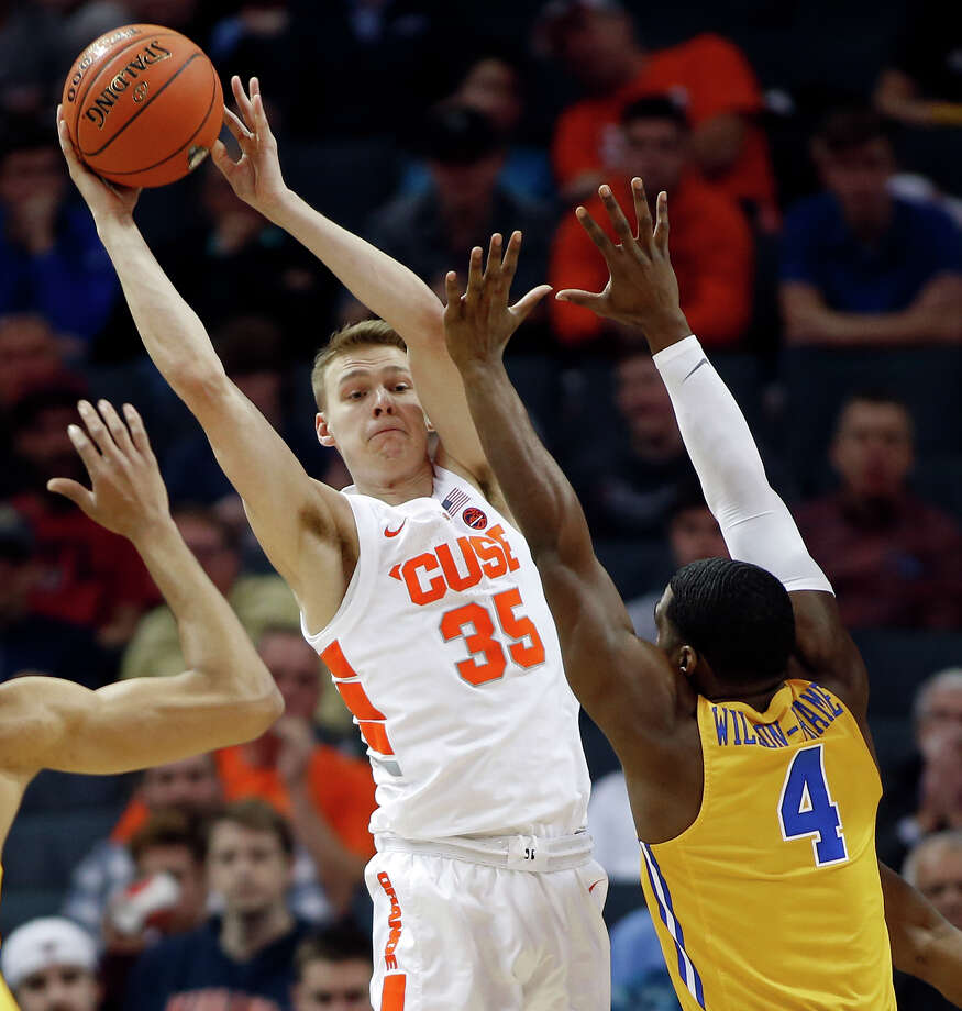 Syracuse's Buddy Boeheim (35) looks to pass the ball as Pittsburgh's Jared Wilson-Frame (4) defends during the first half of an NCAA college basketball game in the Atlantic Coast Conference tournament in Charlotte, N.C., Wednesday, March 13, 2019. (AP Photo/Nell Redmond) Photo: Nell Redmond / Copyright 2019 The Associated Press. All rights reserved