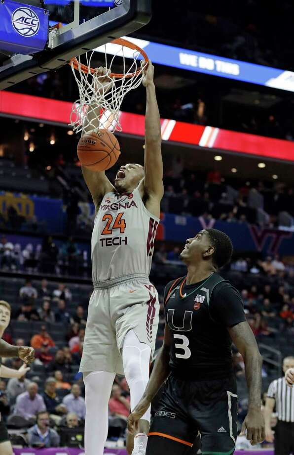 Virginia Tech's Kerry Blackshear Jr. (24) dunks past Miami's Anthony Lawrence II (3) during the second half of an NCAA college basketball game in the Atlantic Coast Conference tournament in Charlotte, N.C., Wednesday, March 13, 2019. (AP Photo/Nell Redmond) Photo: Nell Redmond / Copyright 2019 The Associated Press. All rights reserved