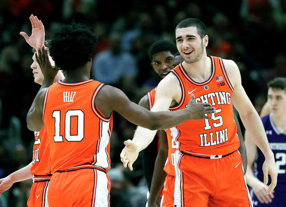 Illinois forward Giorgi Bezhanishvili, right, smiles as he celebrates with guard Andres Feliz after scoring a basket against Northwestern in Wednesday night's game in the first round of the Big Ten Conference Tournament in Chicago. Photo: AP Photo