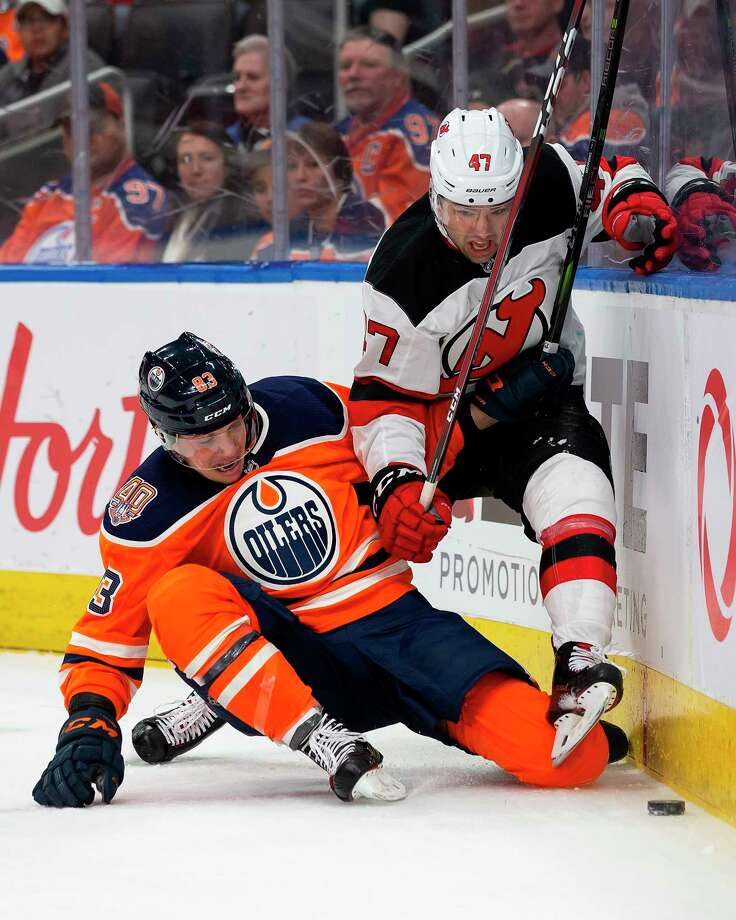 Edmonton Oilers' Matthew Benning (83) battles New Jersey Devils' John Quenneville (47) during the first period of an NHL hockey game, Wednesday, March 13, 2019, in Edmonton, Alberta. (Codie McLachlan/The Canadian Press via AP) Photo: Codie McLachlan / The Canadian Press