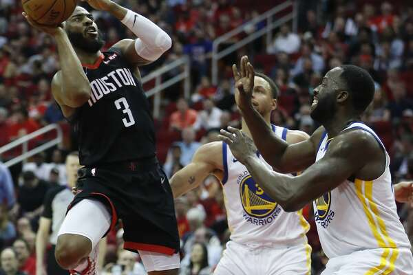 0502acdc1d9 1of51Houston Rockets guard Chris Paul (3) takes a shot against Golden State  Warriors guard Stephen Curry (30) and forward Draymond Green (23) during  the ...
