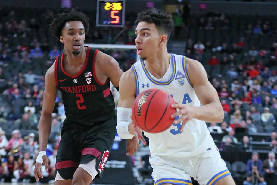 Jules Bernard #3 of the UCLA Bruins handles the ball against Bryce Wills #2 of the Stanford Cardinal during a first-round game of the Pac-12 basketball tournament at T-Mobile Arena on March 13, 2019 in Las Vegas, Nevada. Photo: Leon Bennett / Getty Images / 2019 Leon Bennett