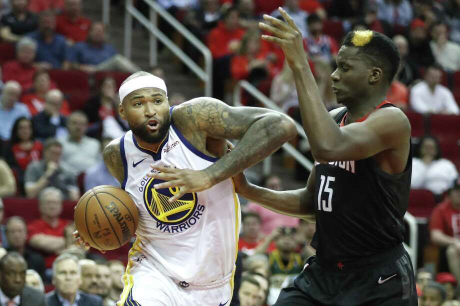 Golden State Warriors center DeMarcus Cousins (0) takes the ball into the lane against Houston Rockets center Clint Capela (15) during the fourth quarter of an NBA basketball game at Toyota Center on Wednesday, March 13, 2019, in Houston. Photo: Brett Coomer / Houston Chronicle / © 2019 Houston Chronicle