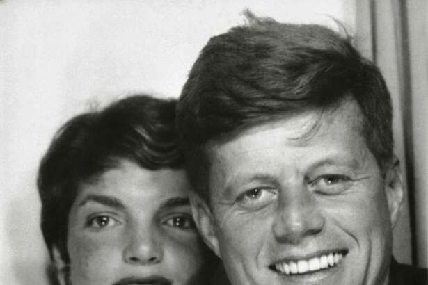 Left ca. 1953. John F. Kennedy first met Jacqueline Lee Bouvier at a dinner party in 1951 and later in Washington, D.C., when she was working as a photographer for the Washington Times-Herald newspaper. Their courtship continued though 1953, some of it captured by the press and popular magazines of the day, such as Life magazine's story of July 20, 1953, featuring an engaging cover photo of the young couple on a sailboat cutting through the Atlantic Ocean surf off Cape Cod with the headline: 'Senator Kennedy Goes A-Courting.' Photo, booth picture