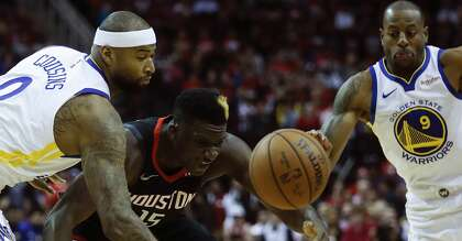 04970daf361 Golden State Warriors center DeMarcus Cousins (0) knocks the ball away from Houston  Rockets center Clint Capela (15) during the first half of an NBA ...