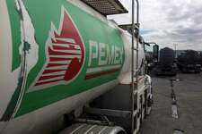 A tanker truck waits at the storage and dispatch terminal of Pemex, Mexico's state-owned oil company, in the port of Veracruz, Mexico. Despite energy market reforms put in place five years ago, Mexican President Andres Manuel Lopez Obrador is moving once again to freeze out foreign oil and gas companies and consolidate the power and influence of Pemex, the state-owned oil company.