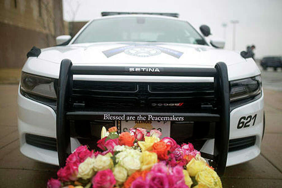 A McHenry County Sheriff's Department vehicle serving as a memorial car is parked outside before services for slain Sheriff's Deputy Jacob Keltner on Wednesday at Woodstock North High School. Keltner was shot and killed while trying to serve an arrest warrant at a hotel on March 7. Photo: Scott P. Yates | Rockford Register Star (AP)