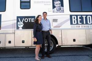 (FILES) In this file photo taken on November 6, 2018 Texas Senatorial Candidate Congressman Beto ORourke and his wife, Amy Hoover Sanders, are pictured in front of a campaign RV outside of Nixon Elementary School in El Paso, Texas. - Beto O'Rourke, the affable former congressman who rose to political stardom last year when he nearly ousted a Republican senator in traditionally conservative Texas, announced on March 14, 2019 he was running for the 2020 presidential race. (Photo by Paul Ratje / AFP)PAUL RATJE/AFP/Getty Images