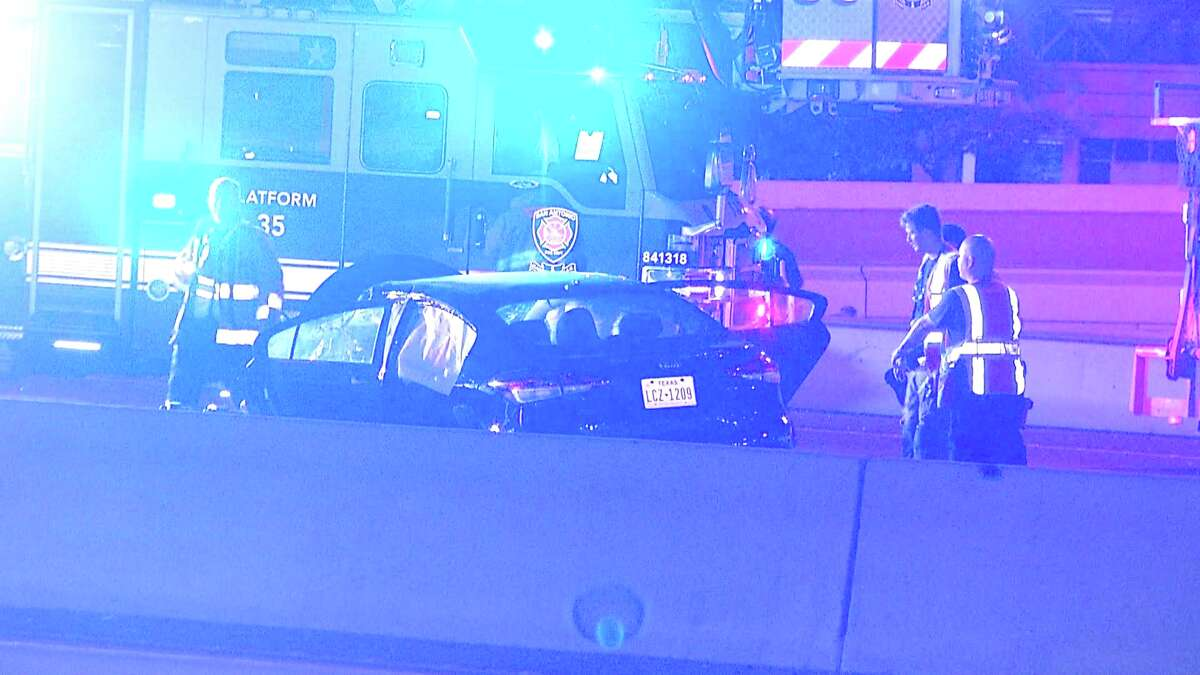 Four people were hospitalized late Wednesday after a driver smashed into the back of a construction truck on the West Side, authorities said.
