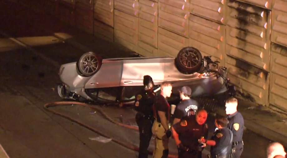 Two people were seriously hurt Wednesday after a Mercedes flew over a concrete barrier and dropped several feet to the Katy Freeway entrance ramp below. Police said an HPD unit had been trying to pull the car over for speeding down the freeway. Photo: Metro Video